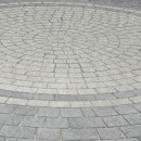 Drivesett Argent Circle set in a Drivesett Argent driveway with a feature band